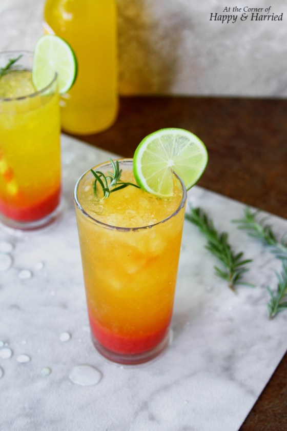 Sunrise Mocktail With Strawberry Syrup, Clementine Soda & Rosemary