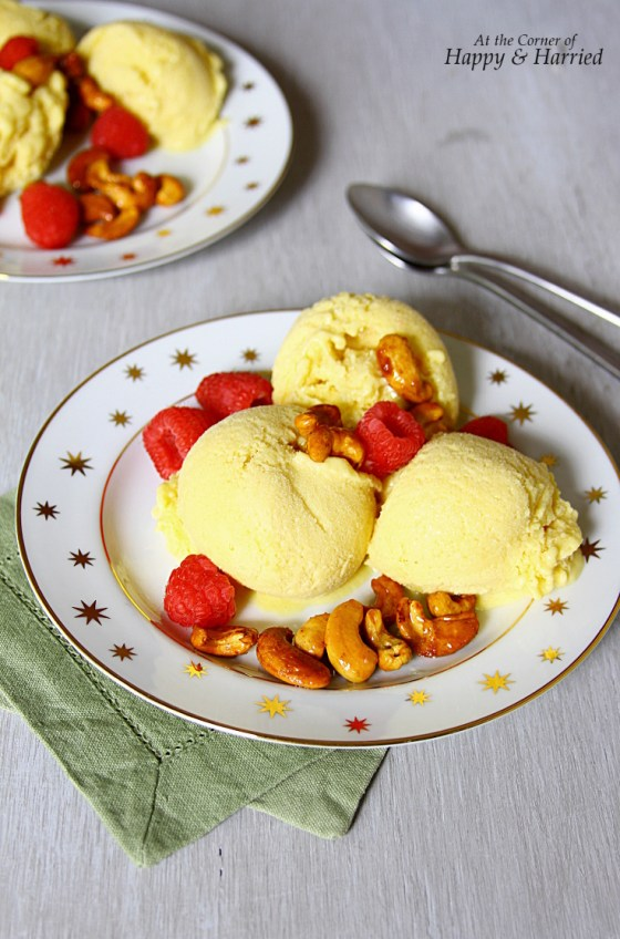 Mango Ice Cream Sundae With Honey Roasted Cashews and Raspberries