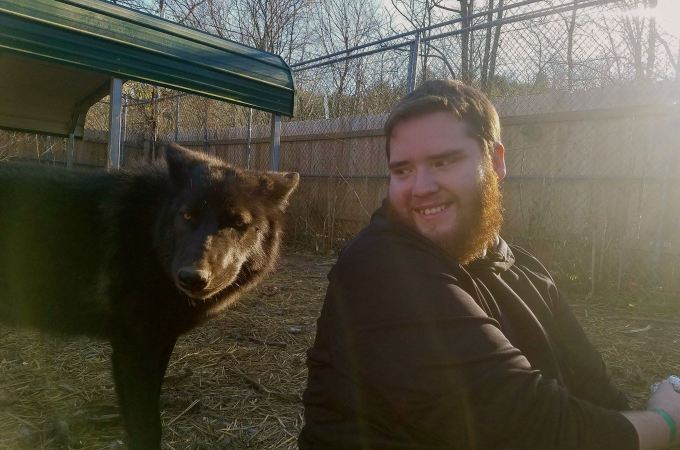 chris-smiling-w-black-wolf