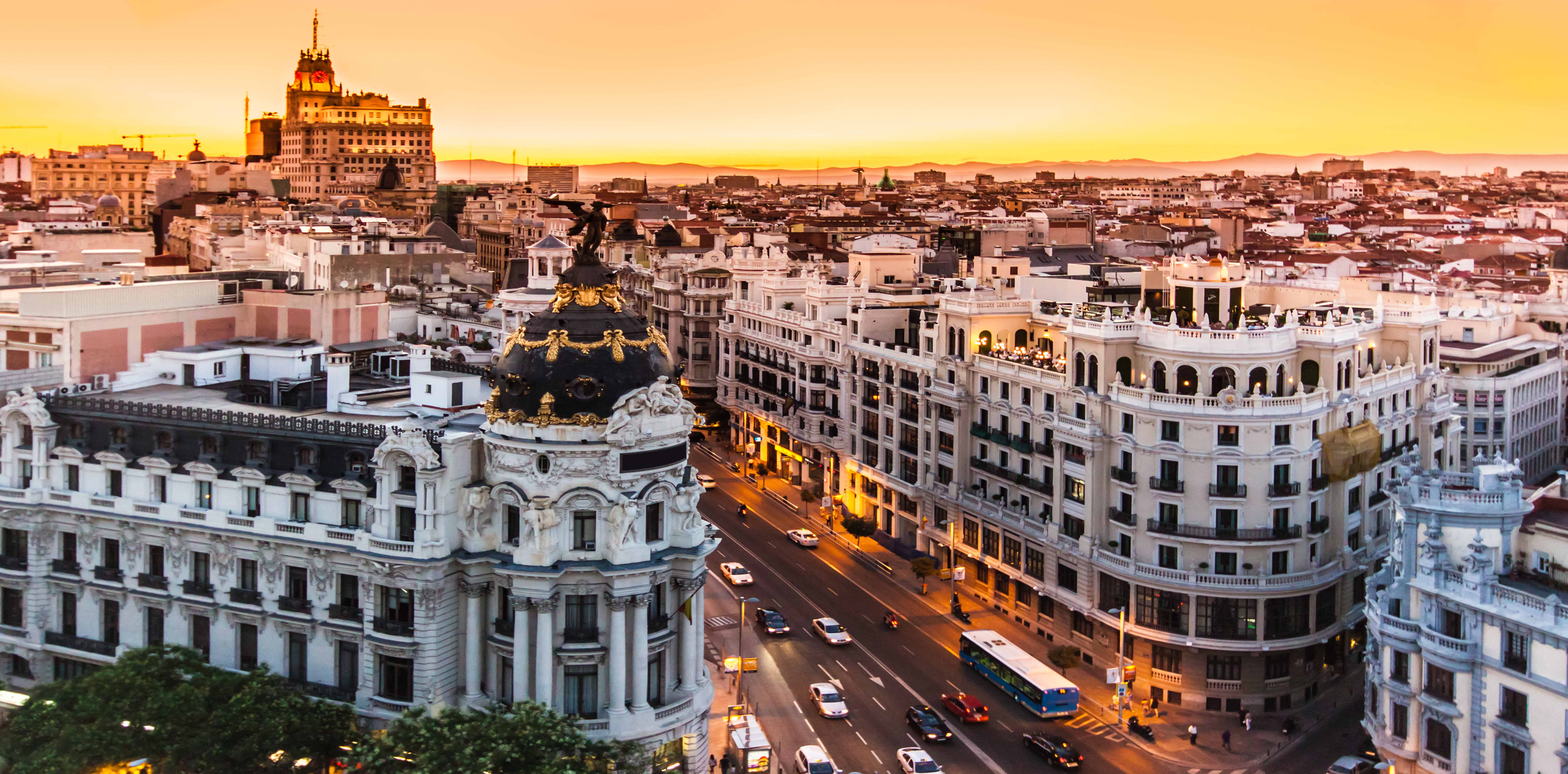 Bright yellow sky over Madrid skyline
