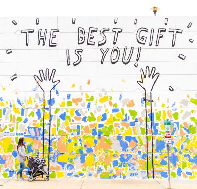 picture of two hands and confetti with text 'the best gift is you'