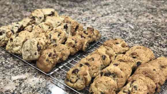 chocolate chip cookies cooling on a rack