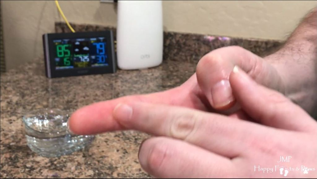 showing with finger how to measure for cooking rice