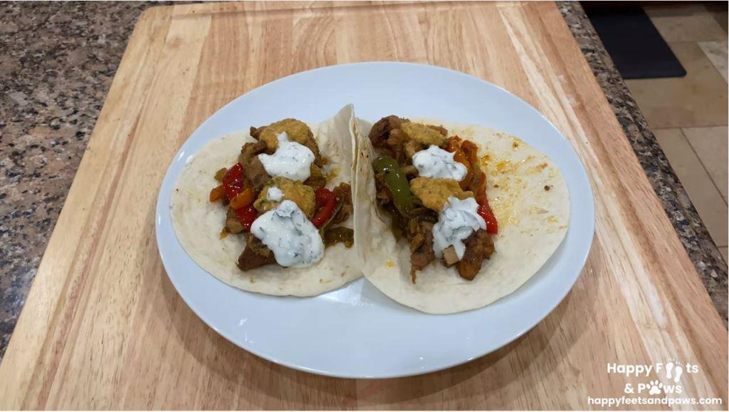 two chicken fajitas on a plate