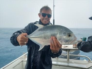 happy fisherman fishing port douglas