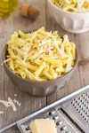 Simple Parmesan Chilli Pasta - This is the easiest and fastest pasta recipe ever! All you have to do is cook the pasta, pour over some good quality extra virgin olive oil, add parmesan + chilli flakes, mix well and you are ready to serve! | happyfoodstube.com
