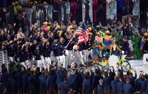 Twenty-two time Olympic medalist swimmer Michael Phelps carries the Stars & Stripes to lead Team USA into Maracana Stadium during the Opening Ceremony of the 2016 Olympic Games in Rio de Janeiro, Brazil, on Aug. 5. U.S. Army photo by Tim Hipps, IMCOM Public Affairs