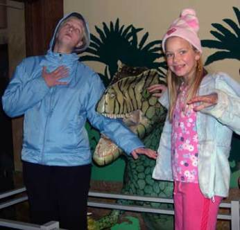 Getting eaten by a dinosaur, my daughters Emily and Louisa at a science museum field trip.