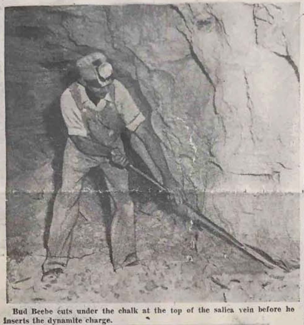 Bud Beebe cuts under the chalk at the top of the salica vein before he inserts the dynamite charge. Photo Credit: Omaha World Herald, Sept. 19, 1943