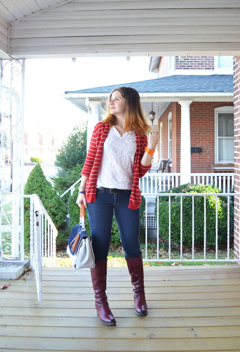 red cardigan with jeans and burgundy boots