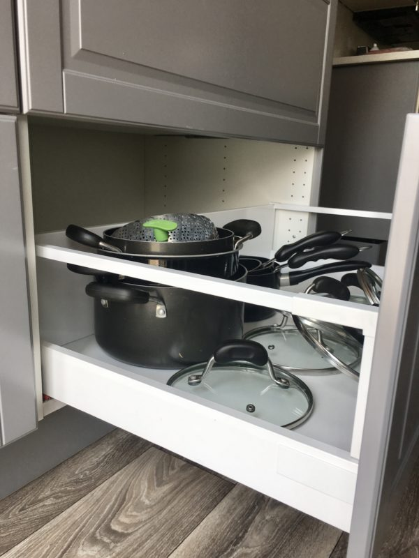 Pros of using Ikea Kitchen cabinets are the deep drawers! These are made of medal, great quality, hold a ton of stuff and look beautiful!!