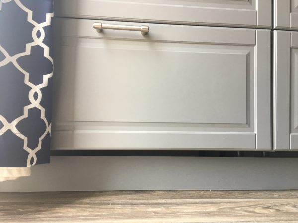 The disadvantages of an Ikea Kitchen Remodel using Grey Ikea Kitchen Cabinets are the toe kicks. They are plastic and only one size.