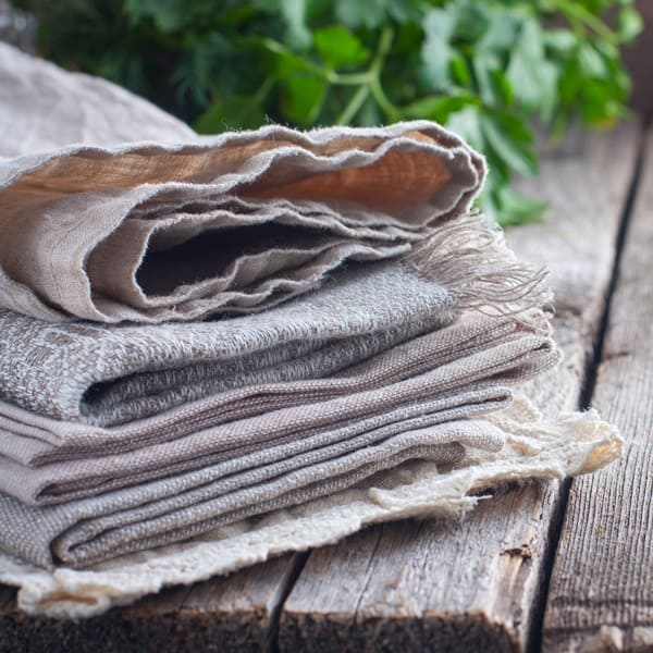Cloth napkins stacked together. Use cloth napkins as a reusable kitchen item.