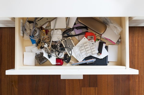Junk drawer full of stuff that needs decluttering