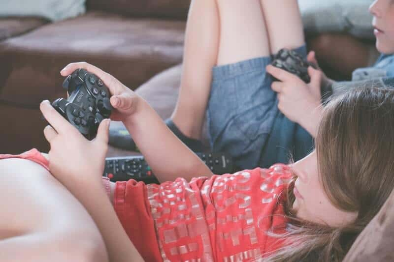 Children playing video games rather than playing outside.