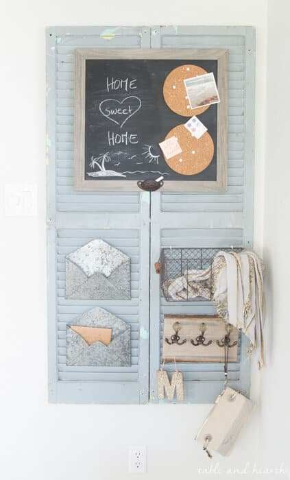 Family command center, farmhouse style made out of old wooden shutters.