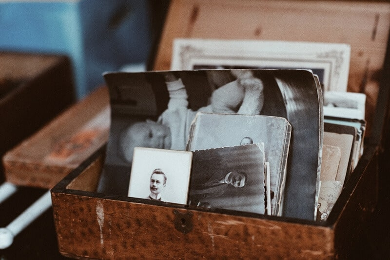 A box of photographs and old memories which can contribute to sentimental clutter.