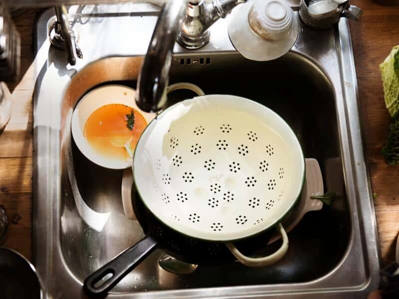 Get the dirty dishes done as part of your speed cleaning checklist.