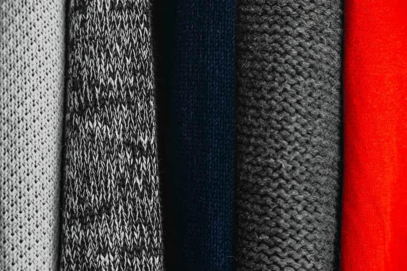 Vertically folded sweaters folded the KonMari way or Japanese way.
