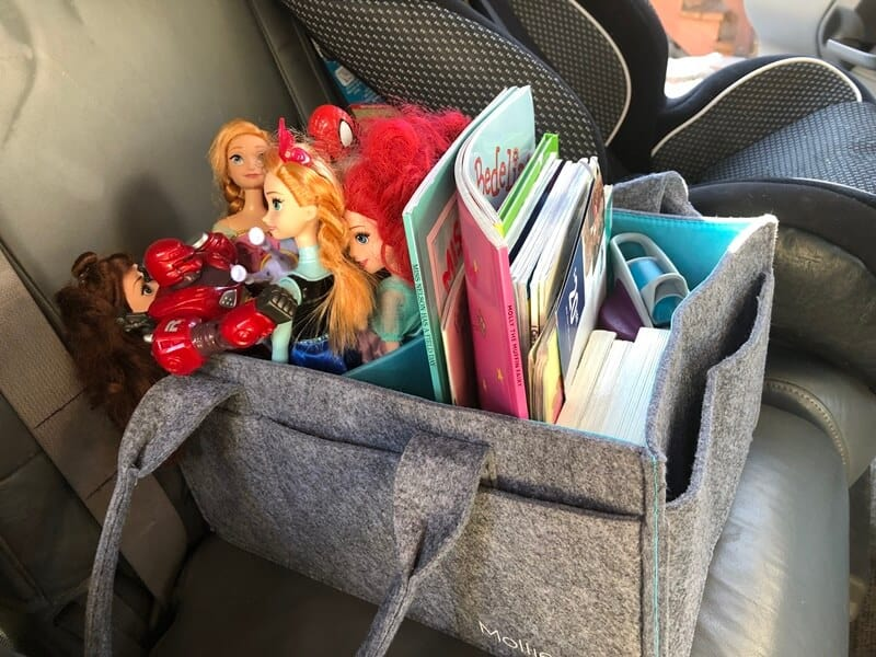 Mimmo Caddie used as our fun bag to carry items on our long car trips. It holds all our activities for kids on a car trip.