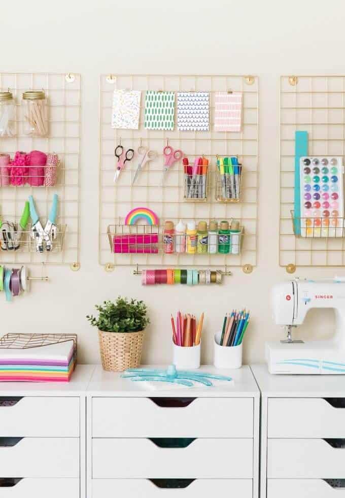 Craft room organization using a wall grid organizer.