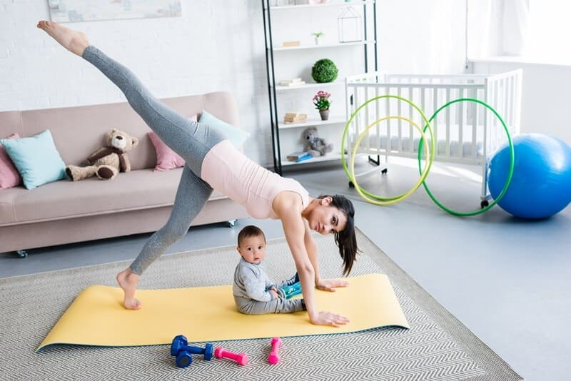 Try Barre or yoga as a workout at home for busy moms.