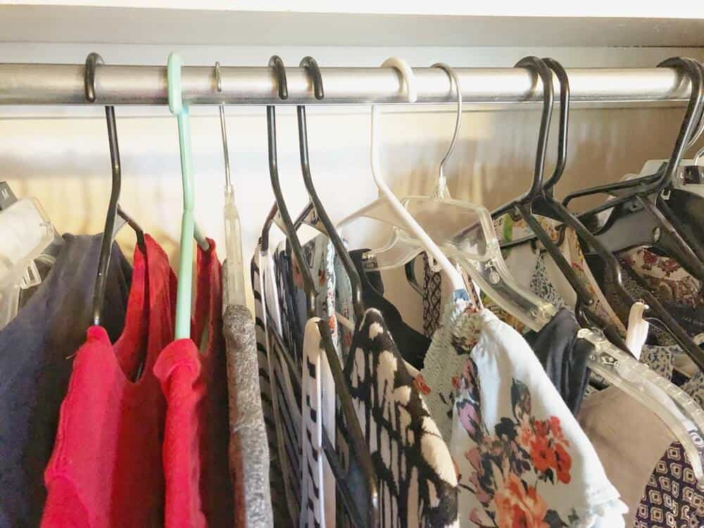 Backward hanger method pictured for cleaning out my closet.