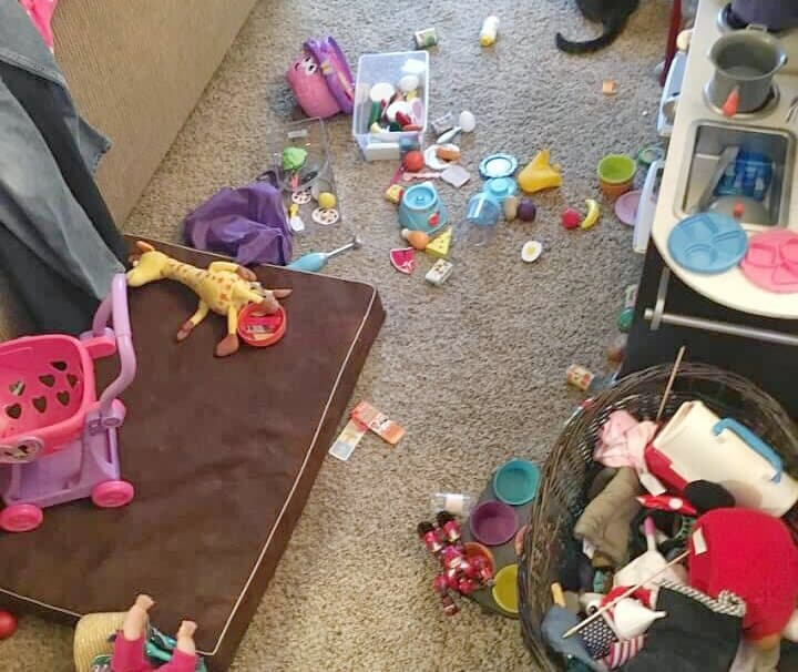 Decluttering tips for messy kid toys. Toys all over the floor.
