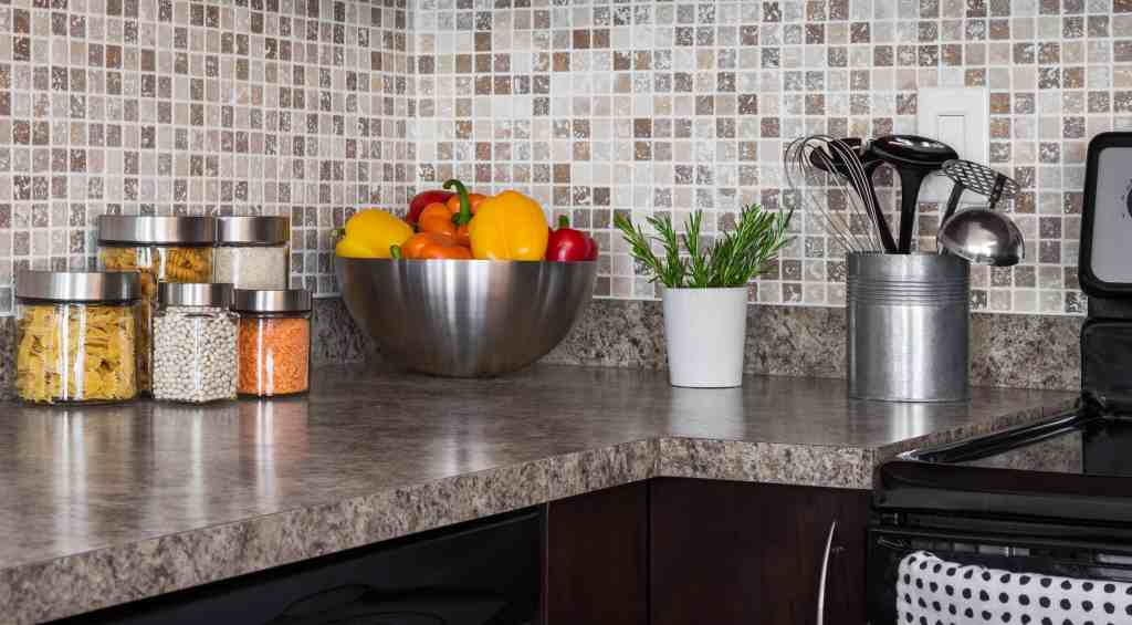 Clean kitchen counters with items stored on them.