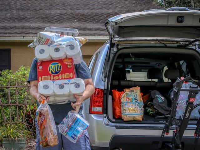 A man hoarding lots of groceries, water and toilet paper making minimalism during a pandemic seem impossible.