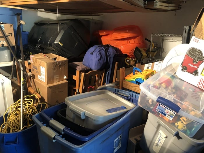 Clutter filled garage. Under all this clutter is cash to be made by selling on Facebook.