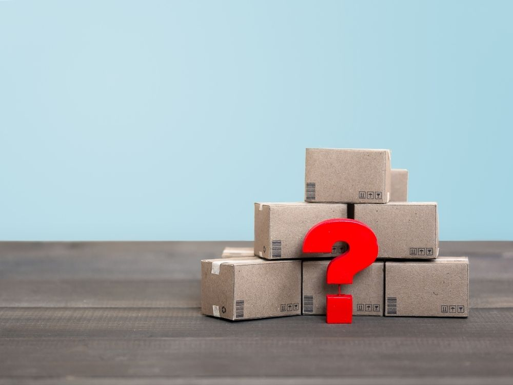 """Picture of """"experiment boxes"""" with a question mark to help with decluttering for a move."""