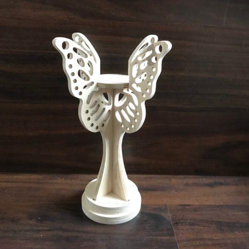 Vlinder kandelaar met gaatjes vleugels