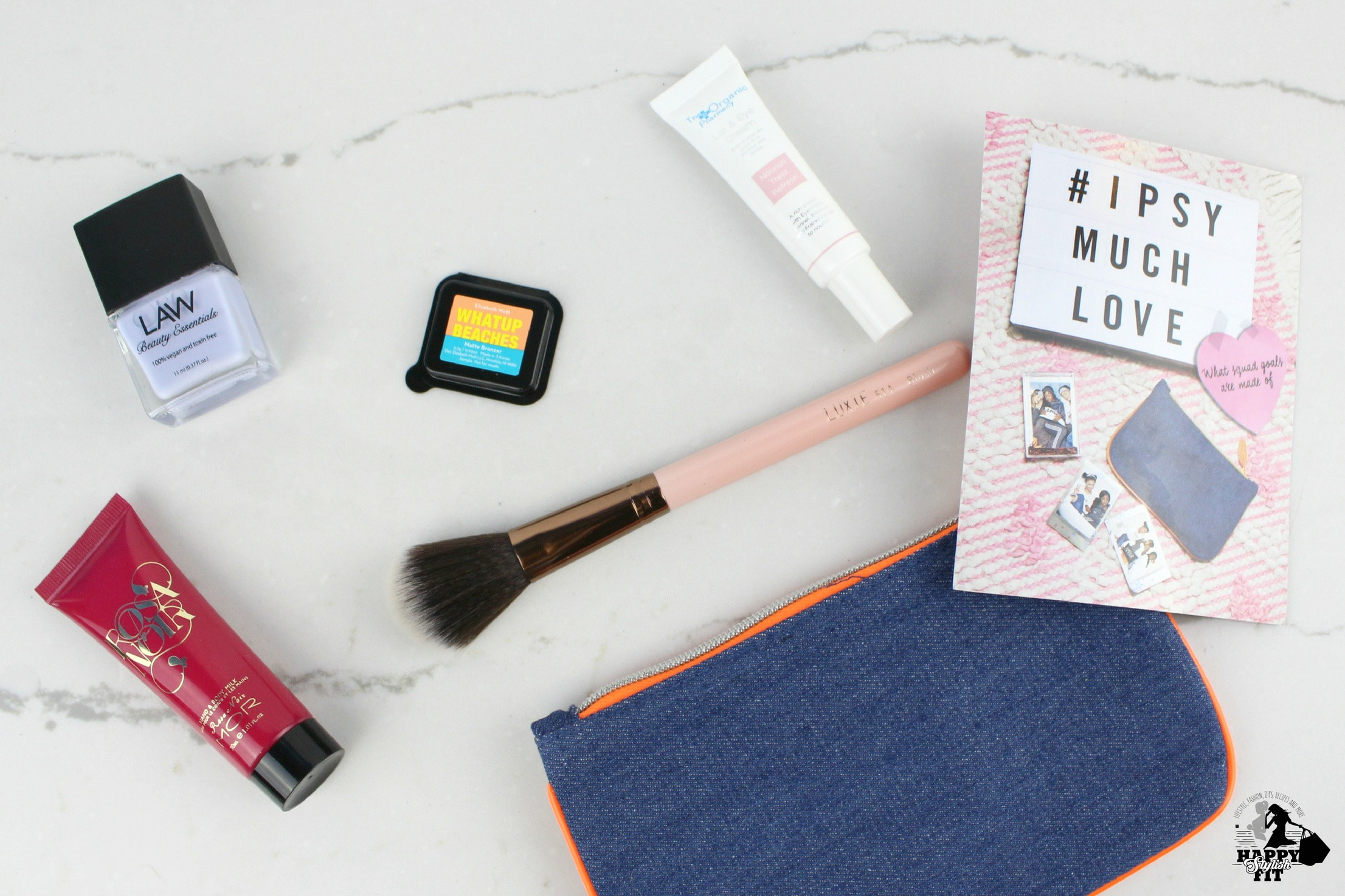 February Ipsy Review featuring Luxie Brushes, Elizabeth Mott Bronzer, Rosa Noir Hand Cream, The Organic Pharmacy Lip and Eye Cream, and Law Beauty Essentials Nail Polish.