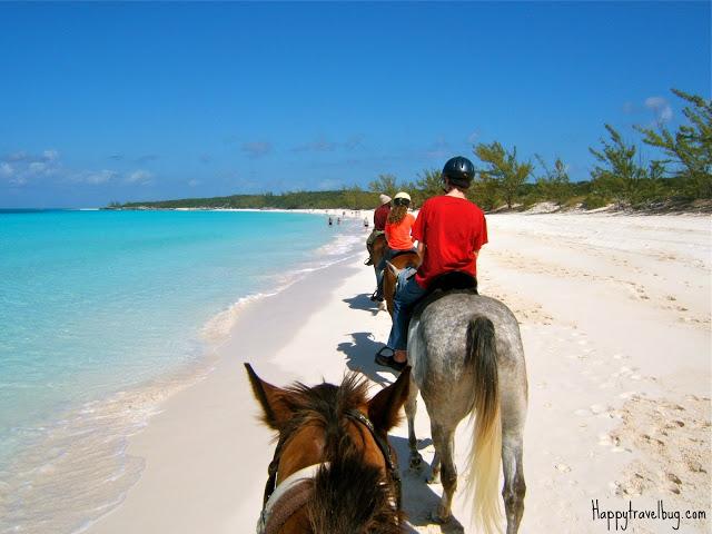 Riding horses along the beach