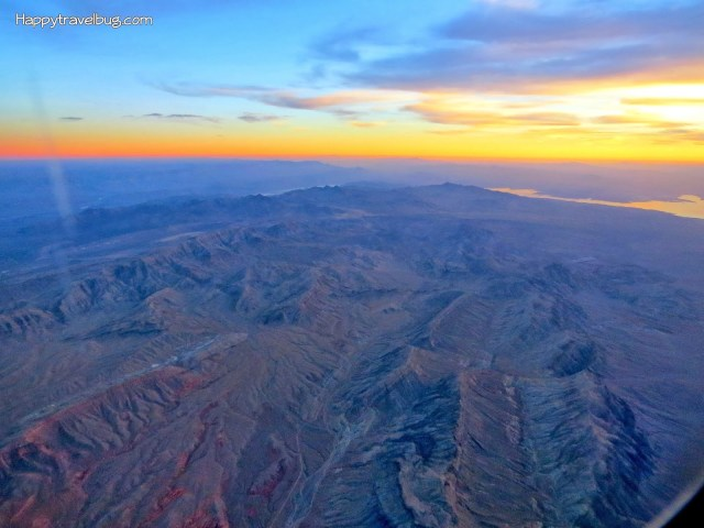 Watching the sun set from my airplane window seat...beautiful! happytravelbug.com