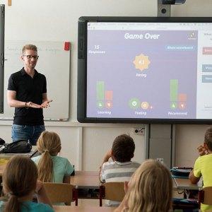 teacher in classroom with smart board