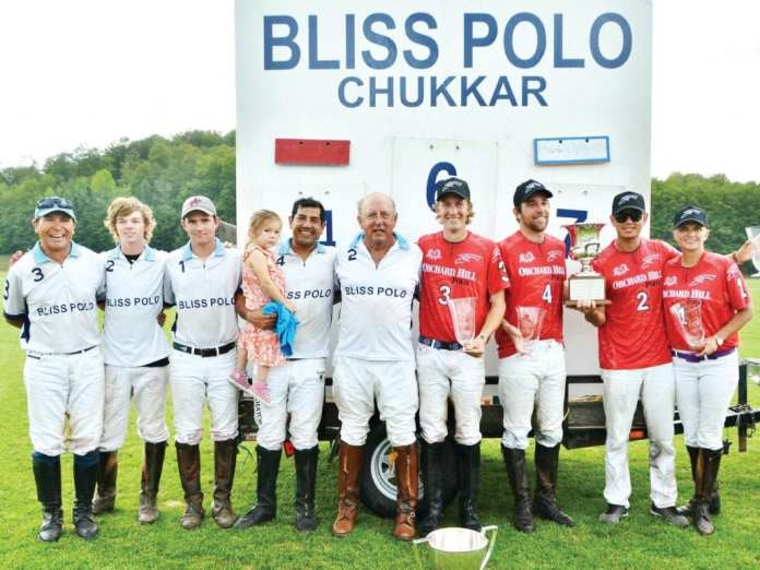 Mason Lampton (center) with his team, Bliss, stands with the Orchard Hill team after the final match of the season. Orchard Hill took this year's cup in a respectable win. Orchard Hill has been playing since the first season against teams like Bliss and Upatoi Blue. (Photo courtesy Gayle Donlon Wolf)