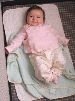 Lea resting in her playpen