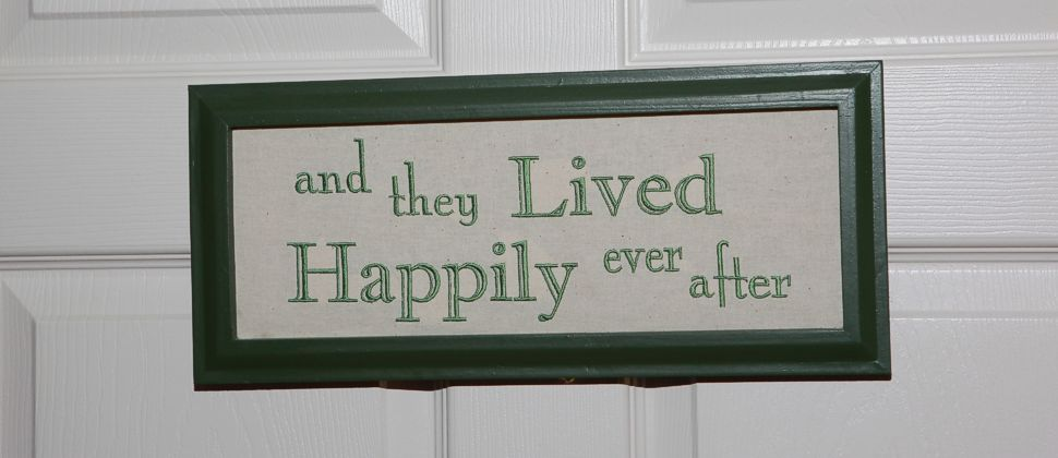 "Green framed sign with the words ""and they Lived Happily ever after"""