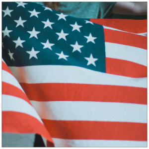 American flag with blue and white starts and red and white stripes - image by jacob-morrison-109043 www.unsplash.com