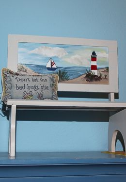 Cute wooden bench decoration with beach scene and small embroidered pillow
