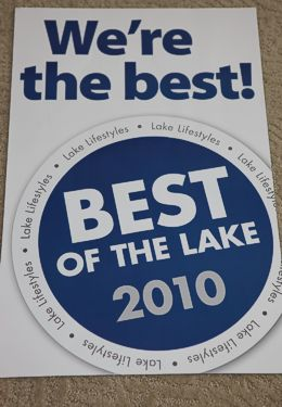 """Rectangular White sign with blue letters saying """"Best of the Lake 2010"""" Award"""