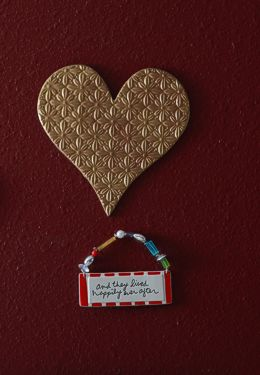 Heart shaped art piece with small hanging sign Happily Ever After