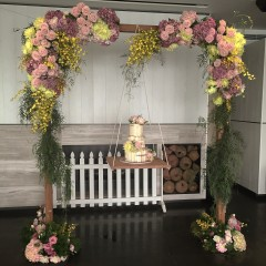 Wooden Arch With Cake Swing Harbourside Decorators