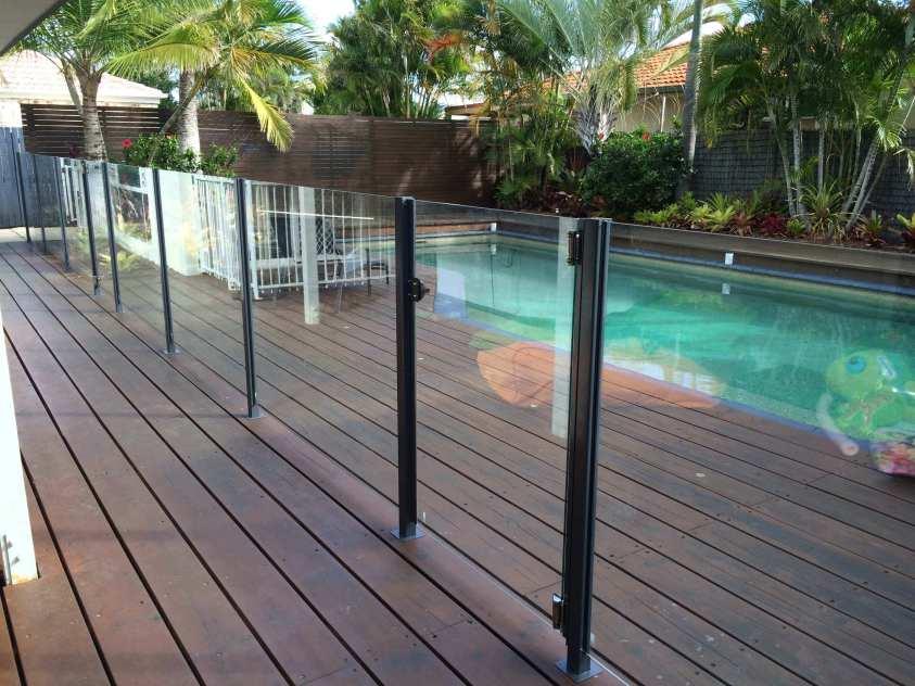 semi frameless glass pool fence on wooden deck