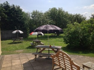 The view from the end of the restaurant of our large, family friendly beer garden. There are swings, a slide and a climbing frame to keep your children amused whilst you enjoy a meal or drink.