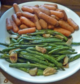 Roasted baby carrots and green beans with garlic cloves