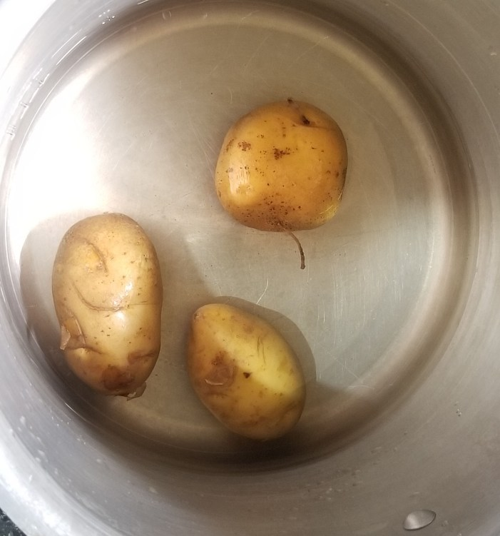 Pressure cook the potatoes for 4 whistles.