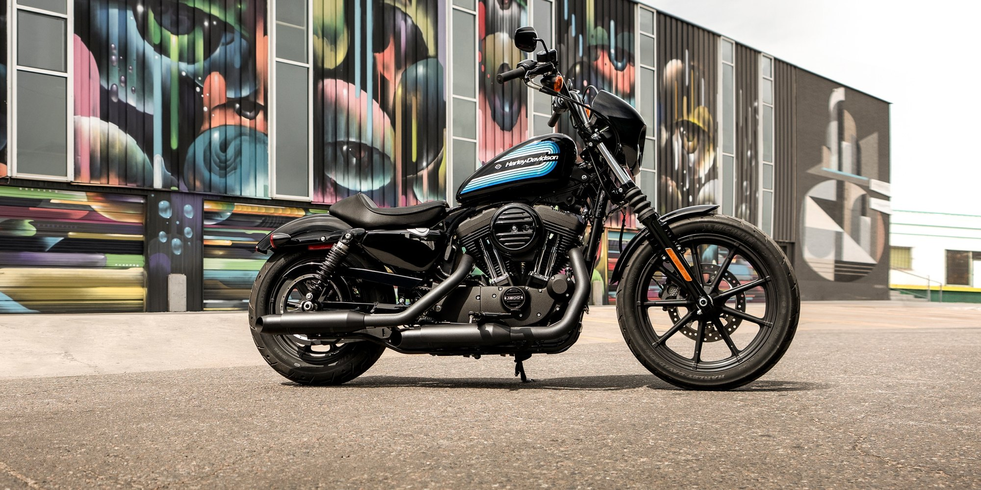 hight resolution of 2019 iron 1200 motorcycle parked in front of a graffiti wall